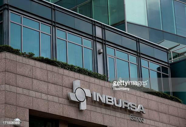 Grupo Financiero Inbursa signage is displayed outside a bank branch in Mexico City Mexico on Tuesday June 25 2013 CaixaBank SA Spains thirdlargest...