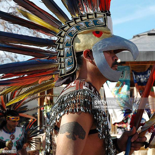 CONTENT] Grupo Tlaloc Danza Azteca a group of Aztec dancers from Denver Colorado performed ceremonial dance at the Plaza in Taos New Mexico in...