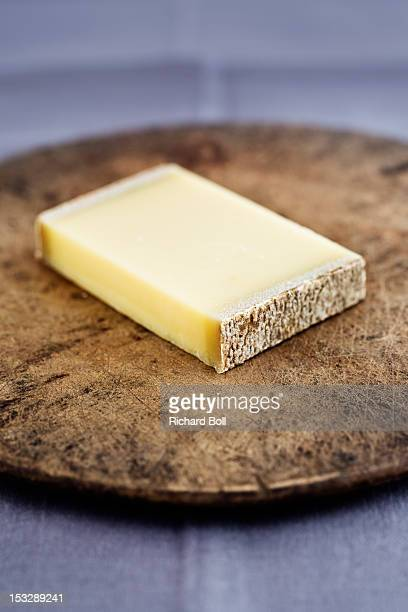 Gruyere cheese on a wooden board