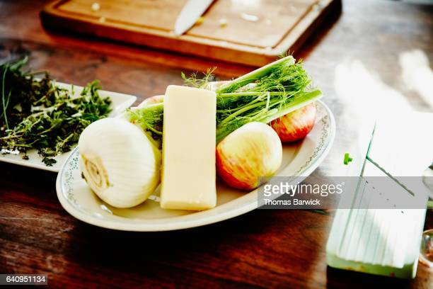Gruyere fennel and apples on plate in kitchen