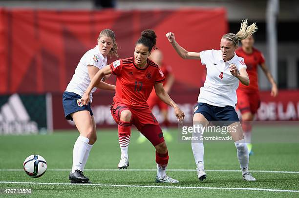 Gry Tofte Ims and Maren Mjelde of Norway challenge Celia Sasic of Germany during the FIFA Women's World Cup Canada 2015 Group B match between Germany...