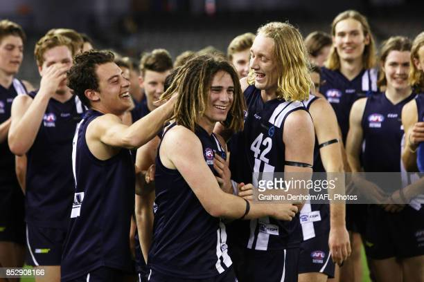 Gryan Miers of the Geelong Falcons is congratulated by teammates after winning best on ground during the TAC Cup Grand Final match between Geelong...