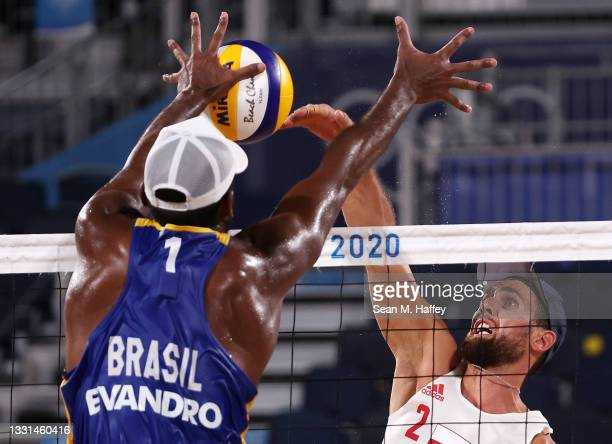 Grzegorz Fijalek of Team Poland competes against Evandro Goncalves Oliveira Junior of Team Brazil during the Men's Preliminary - Pool E beach...