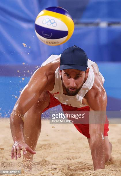 Grzegorz Fijalek of Team Poland competes against Team Brazil during the Men's Preliminary - Pool E beach volleyball on day seven of the Tokyo 2020...