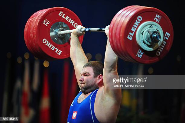 Grzegorz Kleszcz from Poland lifts during the Men 105Kg category at the European Weightlifting Championships in Bucharest on April 12 2009 AFP PHOTO...