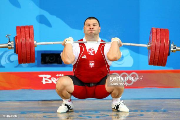 Grzegorz Kleszcz of Poland completes his final lift to win the silver medal in the Men's 105 kg group weightlifting event at the Beijing University...