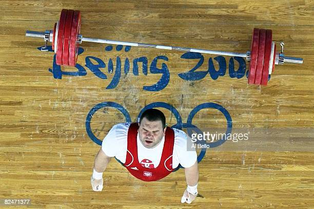 Grzegorz Kleszcz of Poland drops the bar while attempting a lift during the Men's 105 kg group weightlifting event at the Beijing University of...