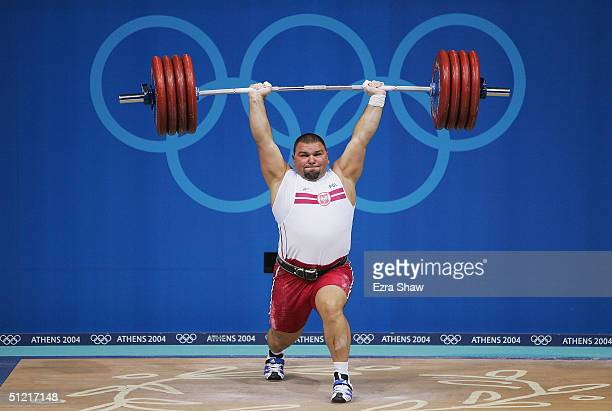 Grzegorz Kleszcz of Poland makes a lift in the men's over 105 kg category weightlifting competition on August 25 2004 during the Athens 2004 Summer...