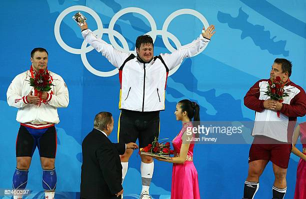 Grzegorz Kleszcz of Poland Matthias Steiner of Germany and Viktors Scebratihs of Latvia celebrate their medals in the Men's 105 kg group...