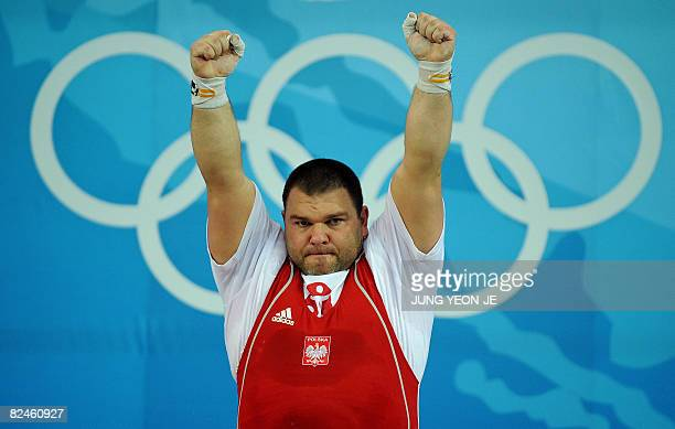 Grzegorz Kleszcz of Poland reacts after a successful lift during the men's 105 kg weightlifting event of the 2008 Beijing Olympic Games in Beijing on...