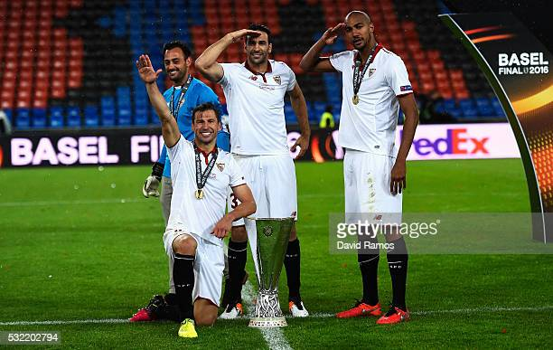Grzegorz Krychowiak Adil Rami and Steven N'Zonzi of Sevilla celebrate with the trophy after the UEFA Europa League Final match between Liverpool and...