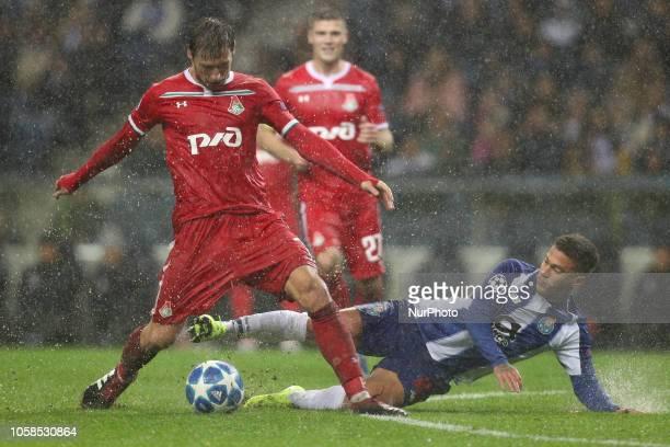 Grzegorz Krychowiak midfielder of FC Lokomotiv Moscow vies with Porto's Brazilian midfielder Otavio during the UEFA Champions League match between FC...