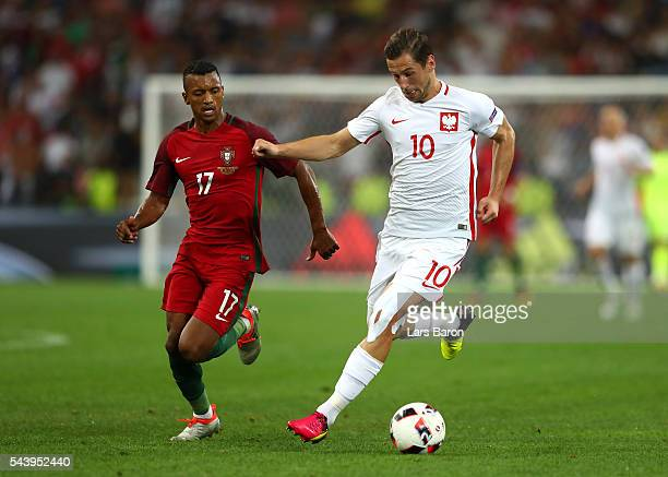 Grzegorz Krychowiak of Poland and Nani of Portugal compete for the ball during the UEFA EURO 2016 quarter final match between Poland and Portugal at...