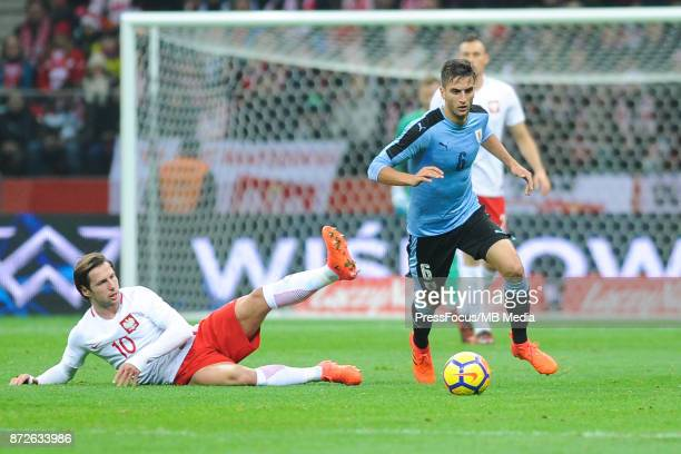 Grzegorz Krychowiak of Poland and Rodrigo Bentancur of Uruguay during the international friendly match between Poland and Uruguay at National Stadium...