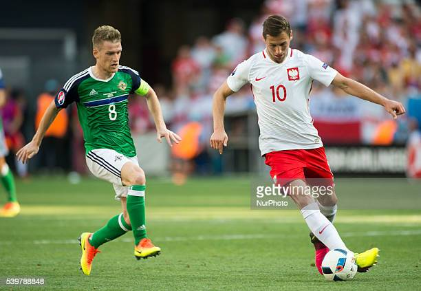 Grzegorz Krychowiak of Poland and Steven Davis of NIreland during the UEFA EURO 2016 Group C match between Poland and Northern Ireland at Stade de...