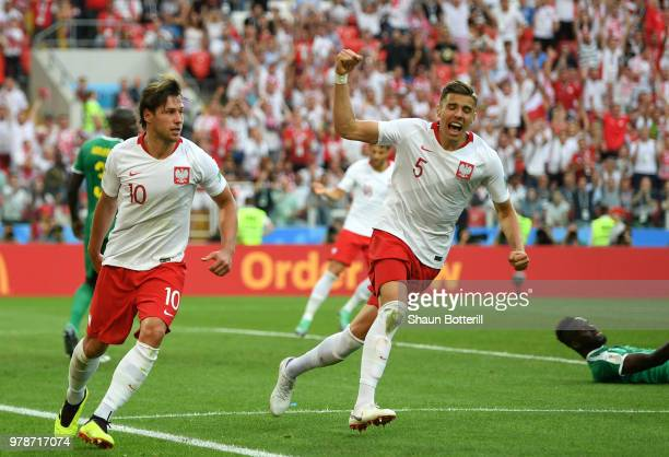 Grzegorz Krychowiak of Poland celebrates with teammate Jan Bednarek after scoring his team's first goal during the 2018 FIFA World Cup Russia group H...