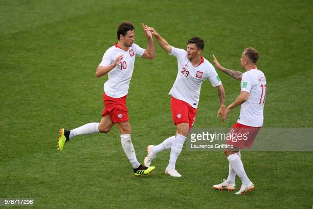 Grzegorz Krychowiak of Poland celebrates with teammates Dawid Kownacki and Kamil Grosicki after scoring his team's first goal during the 2018 FIFA...