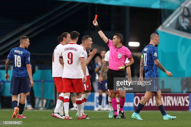 Grzegorz Krychowiak of Poland is shown a red card by Match Referee, Ovidiu Hategan during the UEFA Euro 2020 Championship Group E match between...
