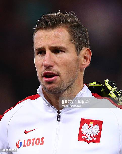 Grzegorz Krychowiak of Poland lines up for the national anthem during the EURO 2016 Qualifier between Scotland and Poland at Hamden Park on October 8...