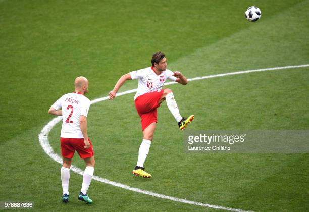 Grzegorz Krychowiak of Poland makes a pass that will end in a Mbaye Niang of Senegal goal to make it 20 during the 2018 FIFA World Cup Russia group H...