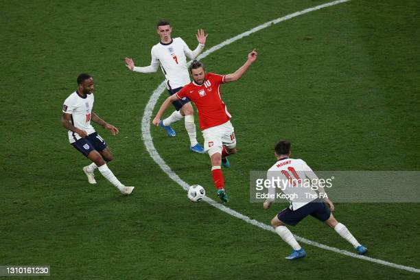 Grzegorz Krychowiak of Poland runs with the ball whilst under pressure from Raheem Sterling, Phil Foden and Mason Mount of England during the FIFA...