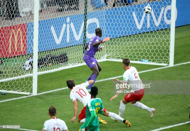 Grzegorz Krychowiak of Poland scores a goal beating goalkeeper of Senegal Khadim N'Diaye during the 2018 FIFA World Cup Russia group H match between...