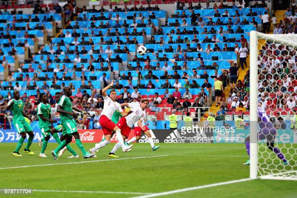 Grzegorz Krychowiak of Poland scores his sides first goal during the 2018 FIFA World Cup Russia group H match between Poland and Senegal at Spartak...