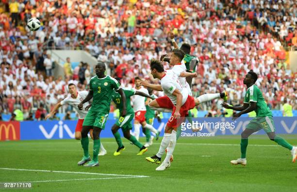 Grzegorz Krychowiak of Poland scores the first Poland goal during the 2018 FIFA World Cup Russia group H match between Poland and Senegal at Spartak...