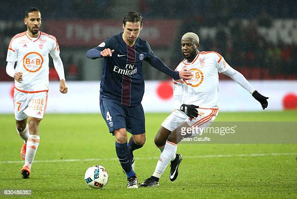 Grzegorz Krychowiak of PSG and Arnold Mvuemba of Lorient in action during the French Ligue 1 match between Paris SaintGermain and FC Lorient at Parc...