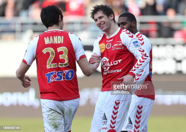 Grzegorz Krychowiak of Reims celebrates with teammate Aissa Mandi after scoring the opening goal from a penalty during the french Ligue 1 match...
