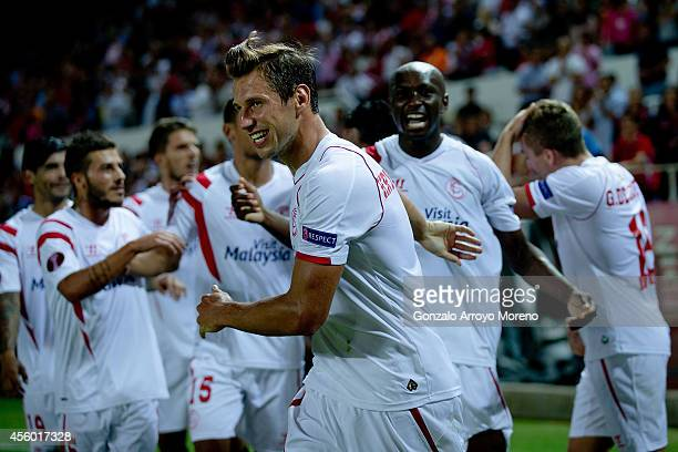 Grzegorz Krychowiak of Sevilla FC celebrates his teammates«s Stephane Mbia Etoundi goal during the UEFA Europa League group G match between Sevilla...