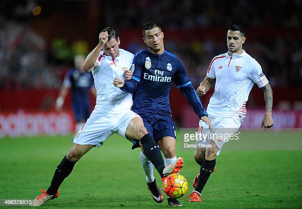 Grzegorz Krychowiak of Sevilla FC cuts off Cristiano Ronaldo of Real Madrid during the La Liga match between Sevilla FC and Real Madrid CF at Estadio...