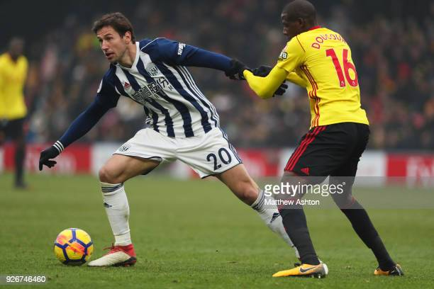 Grzegorz Krychowiak of West Bromwich Albion and Abdoulaye Doucoure of Watford during in the Premier League match between Watford and West Bromwich...