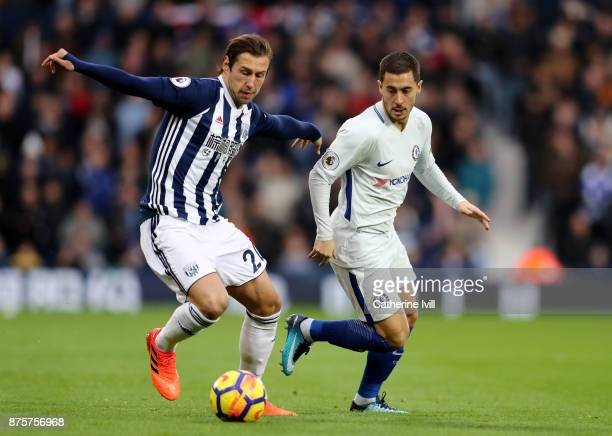 Grzegorz Krychowiak of West Bromwich Albion and Eden Hazard of Chelsea compete for the ball during the Premier League match between West Bromwich...