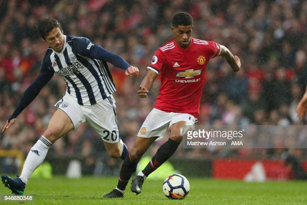 Grzegorz Krychowiak of West Bromwich Albion and Marcus Rashford of Manchester United during the Premier League match between Manchester United and...