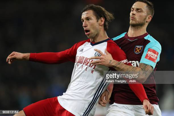 Grzegorz Krychowiak of West Bromwich Albion and Marko Arnautovic of West Ham United during the Premier League match between West Ham United and West...