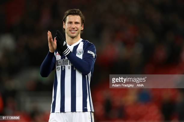 Grzegorz Krychowiak of West Bromwich Albion applauds the travelling West Bromwich Albion Fans at the final whistle celebrating the 23 win over...