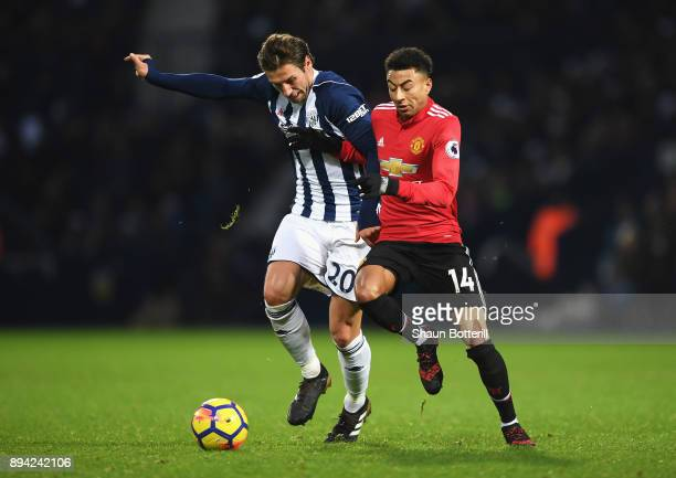 Grzegorz Krychowiak of West Bromwich Albion battles for possesion with Jesse Lingard of Manchester United during the Premier League match between...