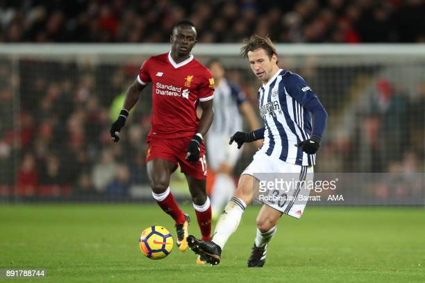 Grzegorz Krychowiak of West Bromwich Albion competes with Sadio Mane of Liverpool during the Premier League match between Liverpool and West Bromwich...