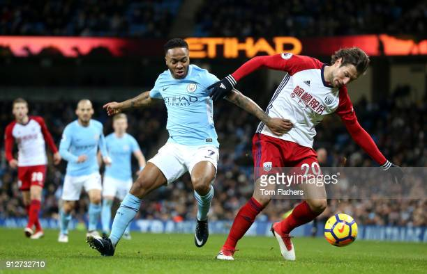 Grzegorz Krychowiak of West Bromwich Albion is challenged by Raheem Sterling of Manchester City during the Premier League match between Manchester...