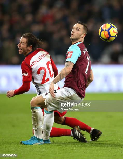 Grzegorz Krychowiak of West Bromwich Albion is fouled by Marko Arnautovic of West Ham United during the Premier League match between West Ham United...