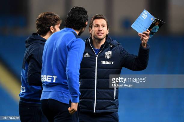 Grzegorz Krychowiak of West Bromwich Albion speaks to his team mates on the pitch prior to the Premier League match between Manchester City and West...