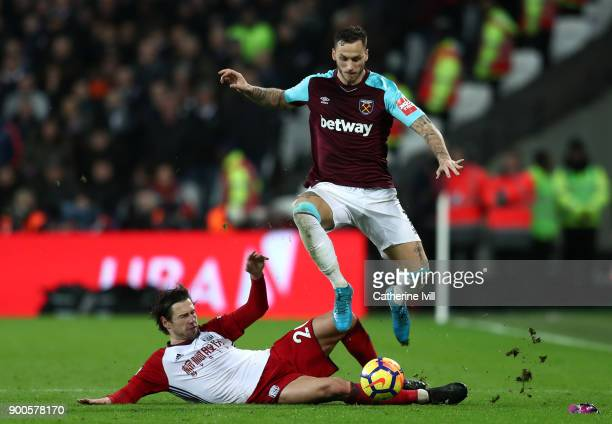Grzegorz Krychowiak of West Bromwich Albion tackles Marko Arnautovic of West Ham United during the Premier League match between West Ham United and...