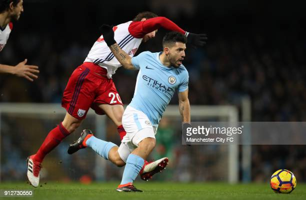 Grzegorz Krychowiak of West Bromwich Albion tackles Sergio Aguero of Manchester City during the Premier League match between Manchester City and West...