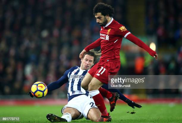 Grzegorz Krychowiak of West Bromwich Alion attempts to tackle Mohamed Salah of Liverpool during the Premier League match between Liverpool and West...