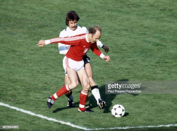 Grzegorz Lato of Hungary is challenged by Herbert Zimmerman of West Germany during the opening match of the FIFA World Cup between West Germany and...