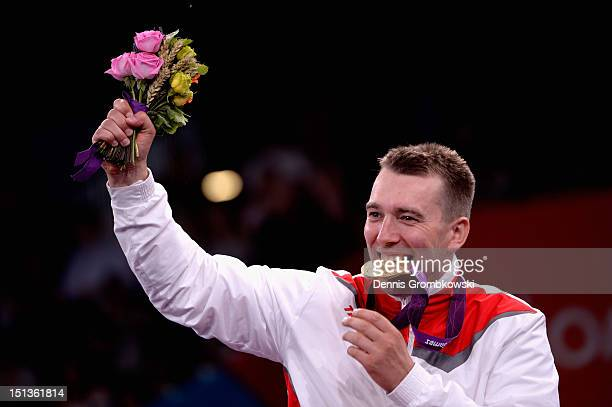 Grzegorz Pluta of Poland celebrates after winning the gold in Men's Individual Sabre Wheelchair Fencing Category B on day 8 of the London 2012...