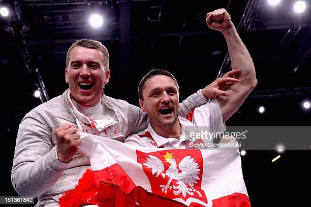 Grzegorz Pluta of Poland celebrates with coach Marek Gniewkowski after winning the gold in Men's Individual Sabre Wheelchair Fencing Category B on...