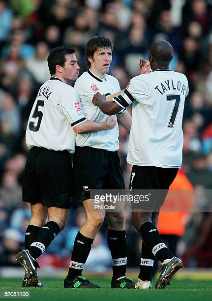Grzegorz Rasiak of Derby Celebrates his goal with team mates Jeff Kenna Ian Taylor during the CocaCola Championship match between West Ham United and...