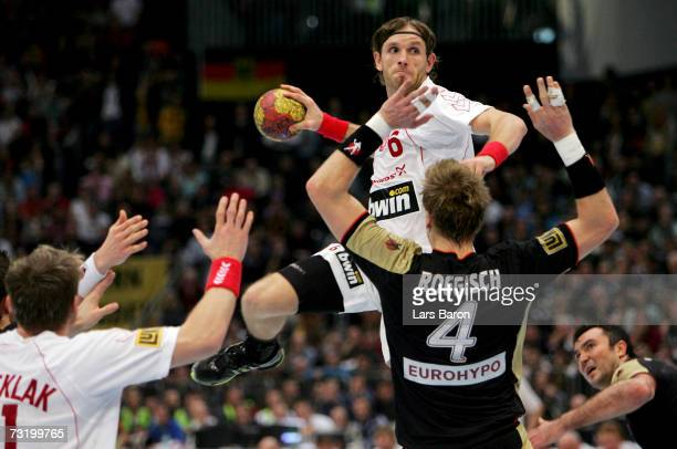 Grzegorz Tkaczyk of Poland in action with Oliver Roggisch of Germany during the IHF World Championship final game between Germany and Poland at the...